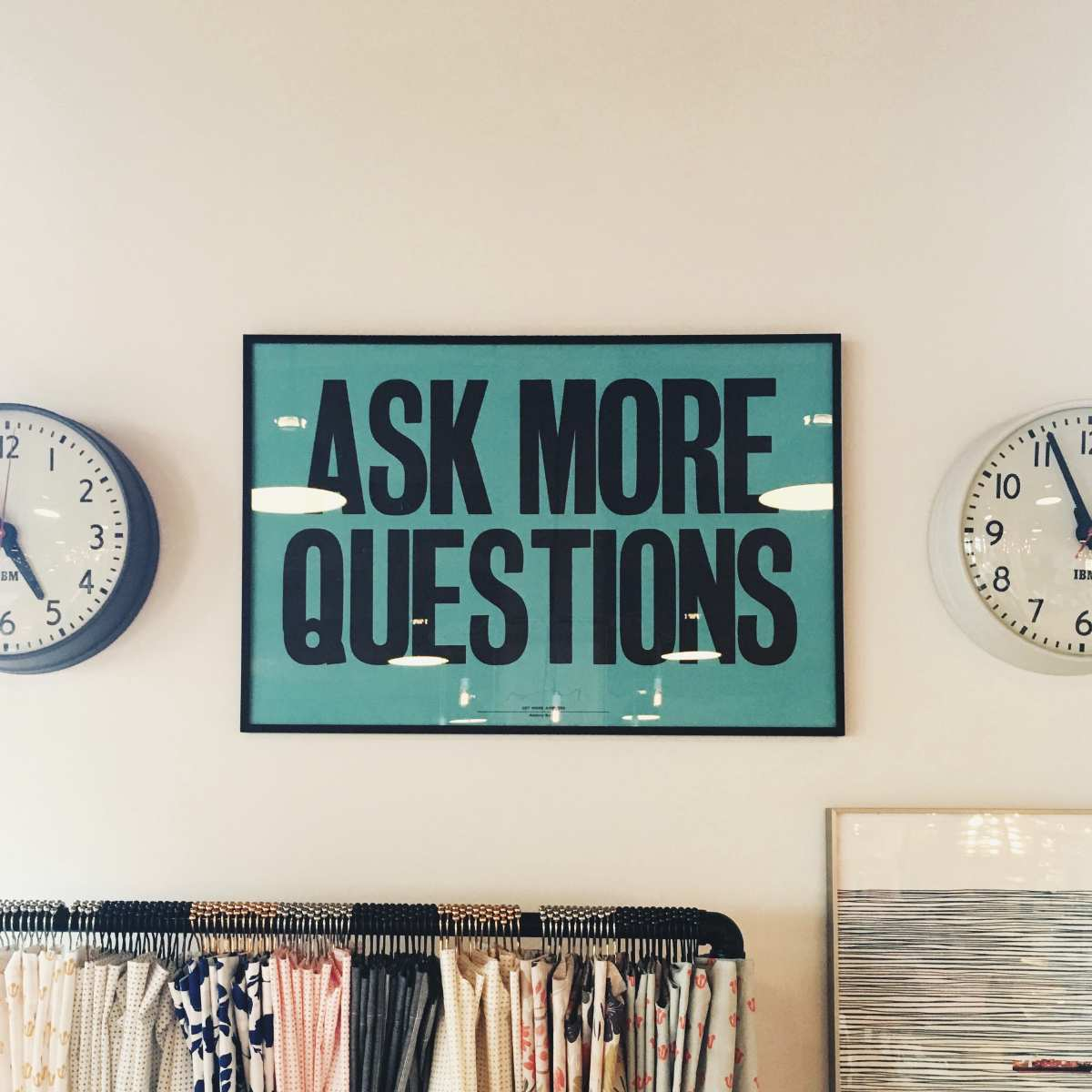 Photo of a poster reading 'Ask more questions'