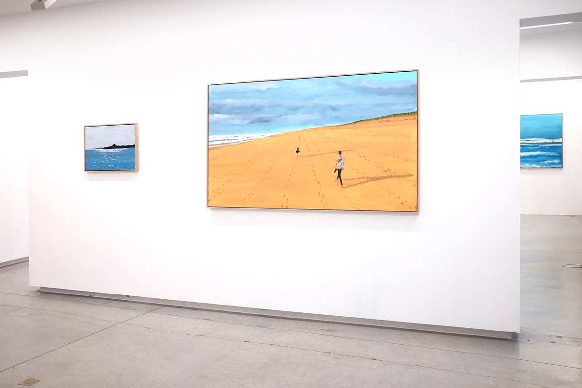 Paintings on display in a gallery